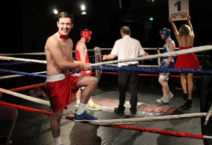 Ring man Conor Hawkings holding the ropes to help ring girl Claire Prenty to get on and off the boxing ring during the RAG Rumble event on Thursday night. The event organised by DCU's RAG Society raised almost €4,000 through ticket sales, donations and sponsorships. The sum will be destined to social projects in local areas such as Ballymun. (Gianluca Avagnina Photography)