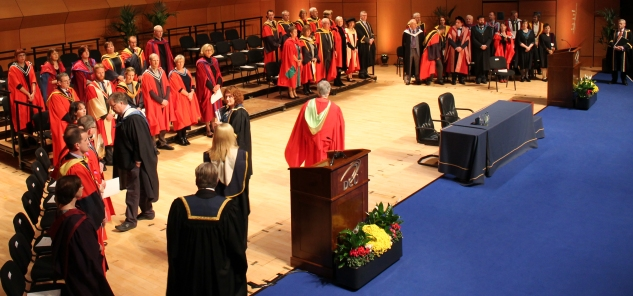 "University dignitaries take their place on the stage of the Mahony Hall in The Helix on Thursday afternoon, following the academic procession in which they marched accompanied by the notes of ""Ceirtlín na Cinniúna"", the DCU anthem. The number of DCU graduates reached 50,000 the following day, in the year that also marks the 25th anniversary since when DCU gained the university status (Gianluca Avagnina Photography)."