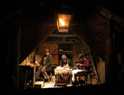 CALZOLAI/SHOEMAKERS: Elio Bono, Paolo Rosati, and Michele Vivalda make shoes in their wooden hut on a small road just outside Prea, towards the end of the guided path of the Living Crib. In front of the hut there is one of the several gas streetlamps used during the event. (Gianluca Avagnina Photography)