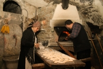 "FORNAIO/BAKER: Laura Botto helps Alberto Bruno, the ""fornaio"", to make the bread. Once ready, small slices of bread were offered to visitors. (Gianluca Avagnina Photography)"